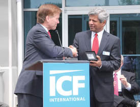 Gov. Bob McDonnell (left) presents a gift to ICF International Chairman and Chief Executive Officer Sudhakar Kesavan during Monday's grand opening ceremony at the company's Martinsville facility.