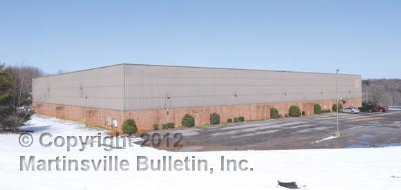 Fred Zoeller, co-founder, president and CEO of LamTech, said LamTech has bought the former Owens-Corning plant (above) in the Martinsville Industrial Park. (Bulletin photos by Mike Wray)