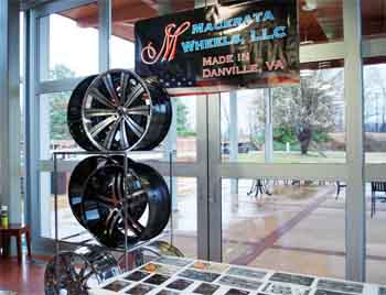 A display of custom wheels that will soon be made in Danville by Macerata Wheels.